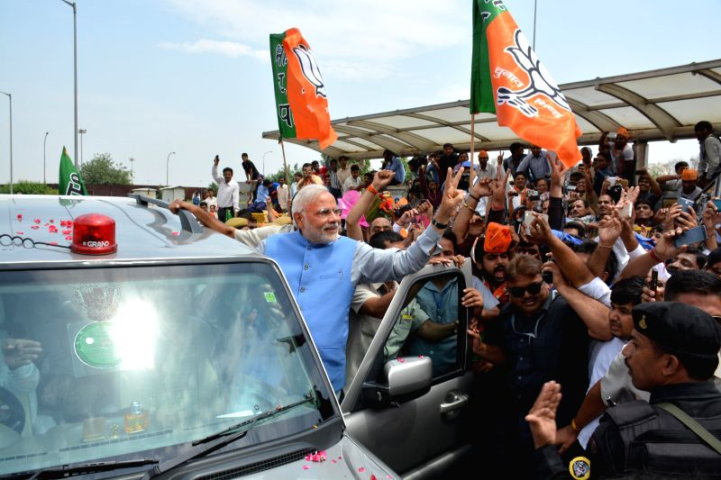 BJP Prime Ministerial candidate Narendra Modi arrives at Indira Gandhi International Airport in New Delhi on May 17, 2014.