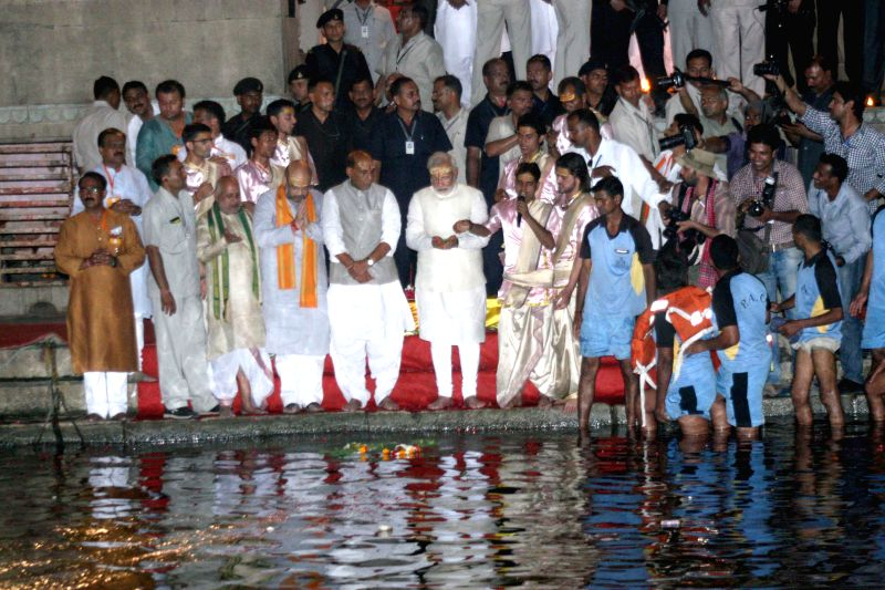 BJP Prime Ministerial candidate Narendra Modi with party president Rajnath Singh and party leader Amit Shah during Ganga-aarti at Dasaswamedh ghat in Varanasi on May 17, 2014. - Rajnath Singh and Amit Shah