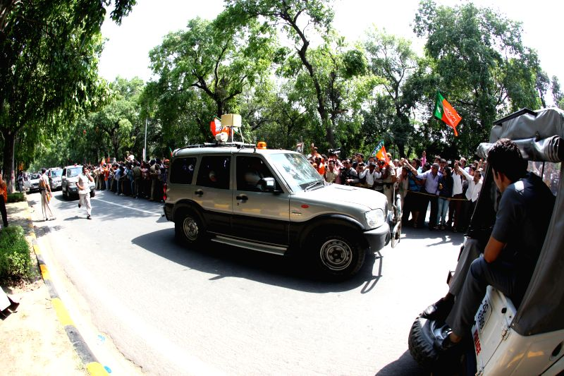 BJP Prime Ministerial candidate Narendra Modi's motorcade leaves BJP headquarters in New Delhi on May 17, 2014.