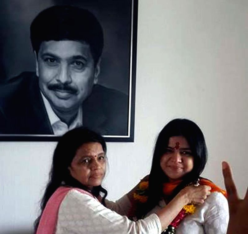 BJP`s candidate for 2014 General Election from North Mumbai, Poonam Mahajan with her mother after winning 2014 Lok Sabha elections in Mumbai on May 16, 2014.