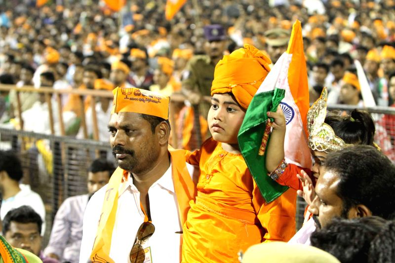 BJP supporters  at party's Prime Ministerial candidate and Gujarat Chief Minister Narendra Modi's rally in Hyderabad on April 22, 2014.