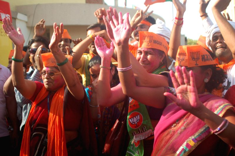 BJP supporters celebrate party's performance in 2014 Lok Sabha Elections in Varanasi on May 16, 2014.