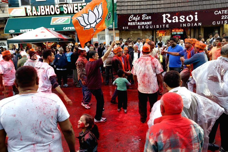 BJP supporters celebrate the victory of party in 2014 Lok Sabha Polls in New Jersey, United States of America on May 17, 2014.