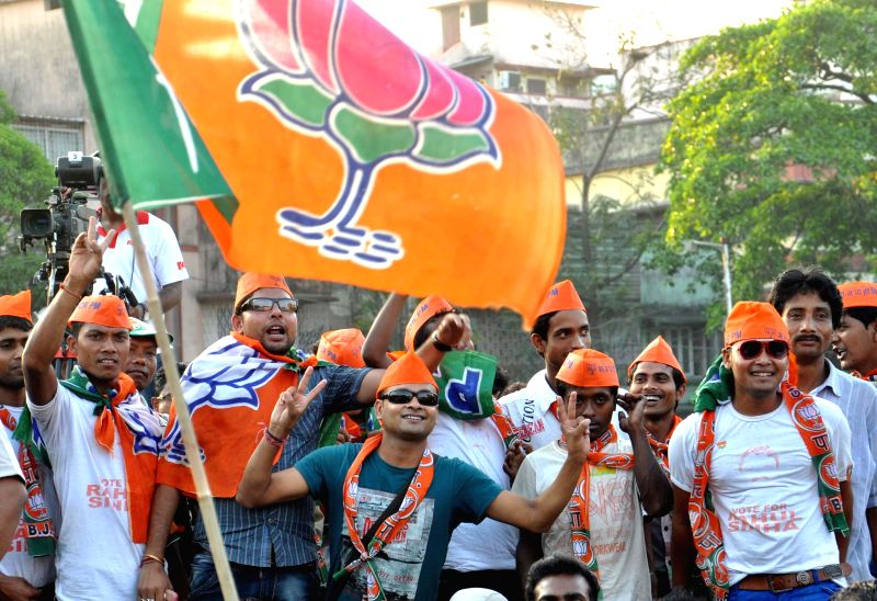 BJP supporters gather at a rally of BJP Prime Ministerial candidate and Gujarat Chief Minister Narendra Modi in Kolkata on May 7, 2014.