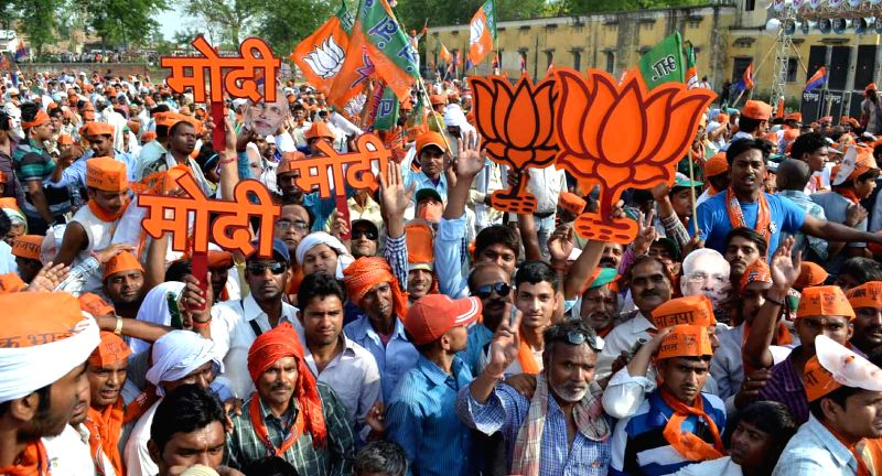 BJP supporters gather at BJP Prime Ministerial candidate and Gujarat Chief Minister Narendra Modi's rally in Rohiniya of Uttar Pradesh on May 8, 2014.