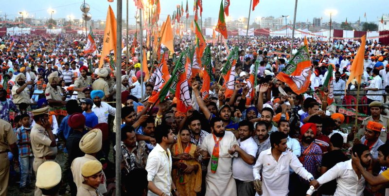 BJP supporters gather at the venue of BJP Prime Ministerial candidate and Gujarat Chief Minister Narendra Modi's rally in Amritsar on April 25, 2014.