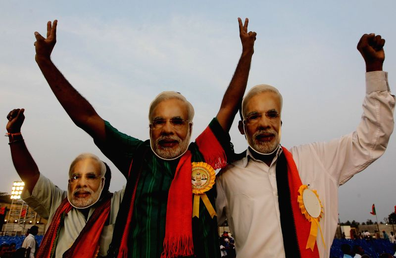 BJP supporters wearing masks of BJP Prime Ministerial candidate and Gujarat Chief Minister Narendra Modi at the venue of Modi's rally in Chennai on April 13, 2014. - Narendra Modi