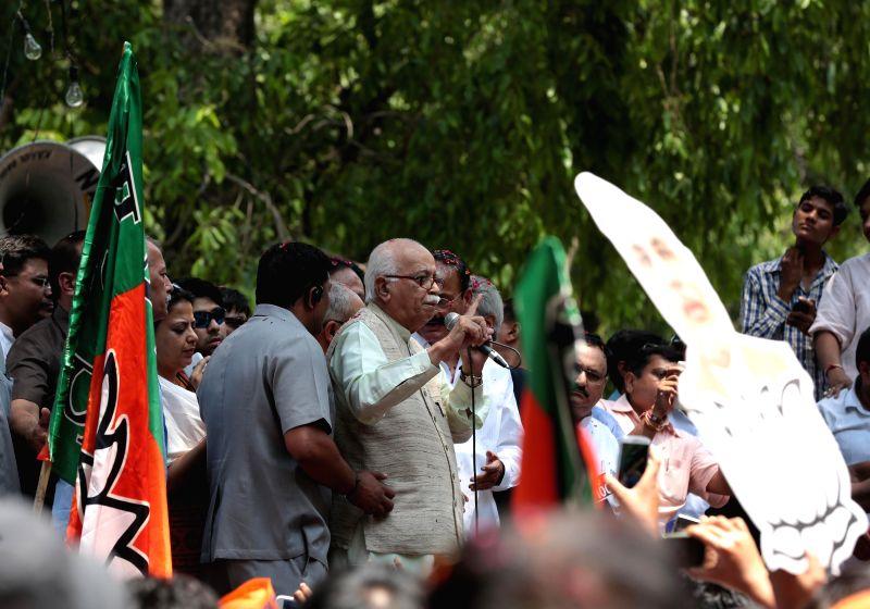 BJP veteran L K Advani addresses at party headquarters in New Delhi on May 16, 2014.