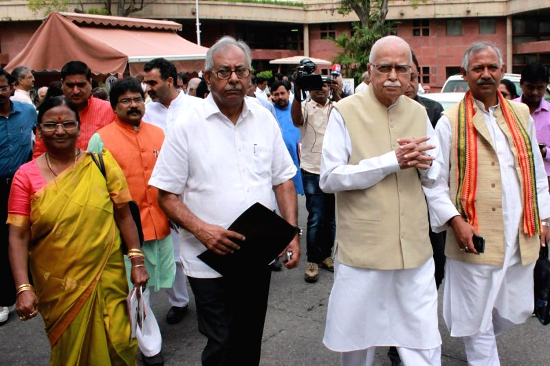 BJP veteran L.K. Advani and others come out after BJP parliamentary party meeting in New Delhi, on Aug 9, 2016. - K. Advani