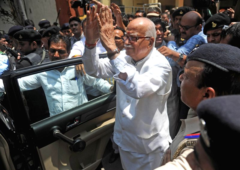 BJP veteran L. K. Advani flashes victory sign after casting his vote at a polling booth during the seventh phase of 2014 Lok Sabha Polls in Ahmedabad on April 30, 2014.