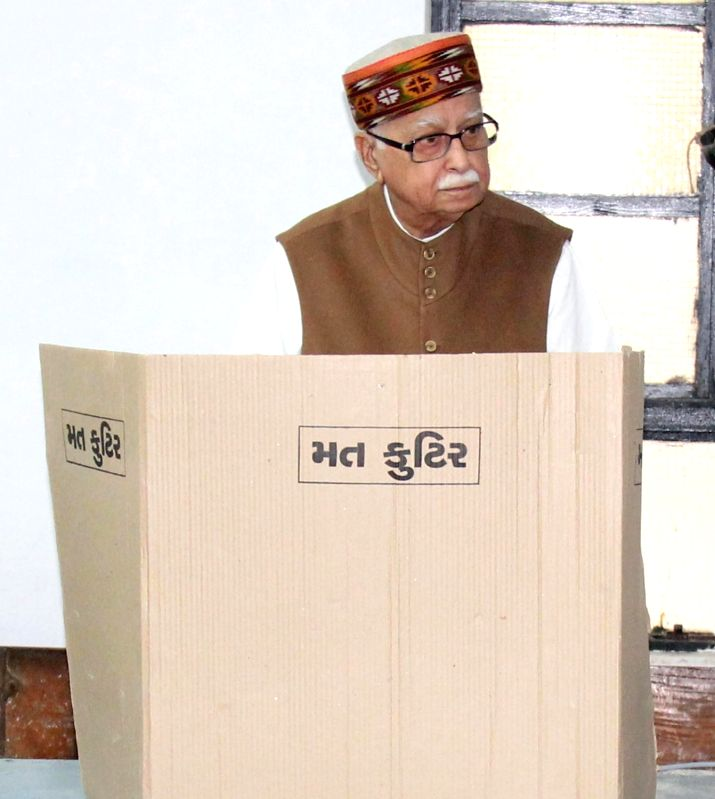 BJP veteran LK Advani casts his vote during the first phase of the two-phase local body elections in Ahmedabad, on Nov 22, 2015.