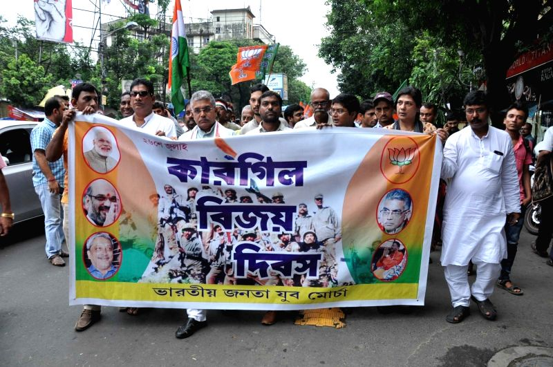 BJP West Bengal Chief Dilip Ghosh with party leaders take part in a rally on the occasion of Kargil Vijay Diwas in Kolkata on July 26, 2016.