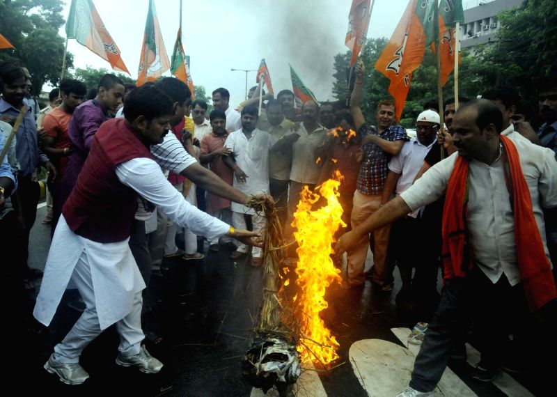 BJP workers burn an effigy of Bihar Chief Minister Nitish Kumar during a protest rally in Patna on July 18, 2016. - Nitish Kumar