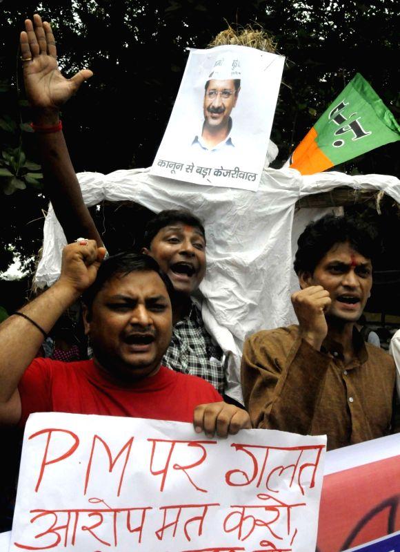 BJP workers burn an effigy of Delhi Chief Minister Arvind Kejriwal in Patna on July 28, 2016. - Arvind Kejriwal