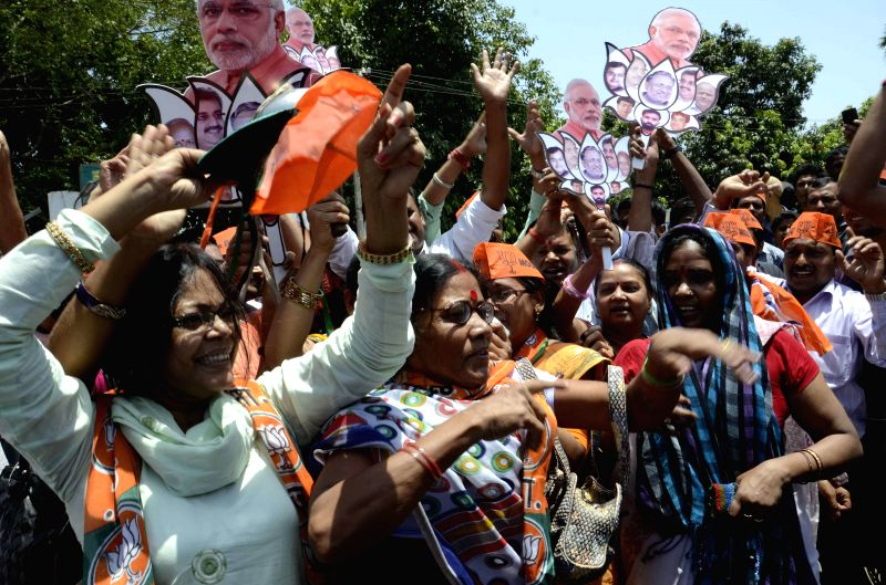 BJP workers celebrate as counting for 2014 Lok Sabha Election is underway and the party is leading nationally, in Patna on May 16, 2014.