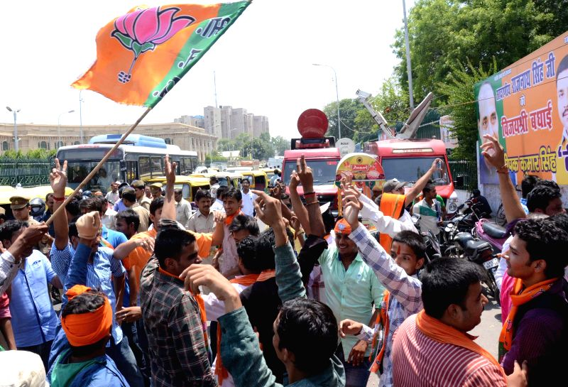 BJP workers celebrate as counting for 2014 Lok Sabha Election is underway and the party is leading nationally, in Lucknow on May 16, 2014.