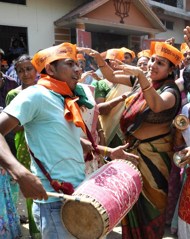 BJP workers celebrate as counting for 2014 Lok Sabha Election is underway and the party is leading nationally, in Guwahati on May 16, 2014.