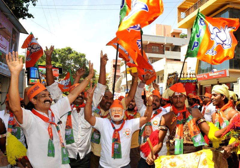 BJP workers celebrate as counting for 2014 Lok Sabha Election is underway and the party is leading nationally, in Bangalore on May 16, 2014.