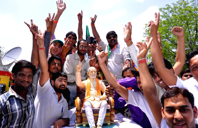 BJP workers celebrate as counting for 2014 Lok Sabha Election is underway and the party is leading nationally, in Jaipur on May 16, 2014.