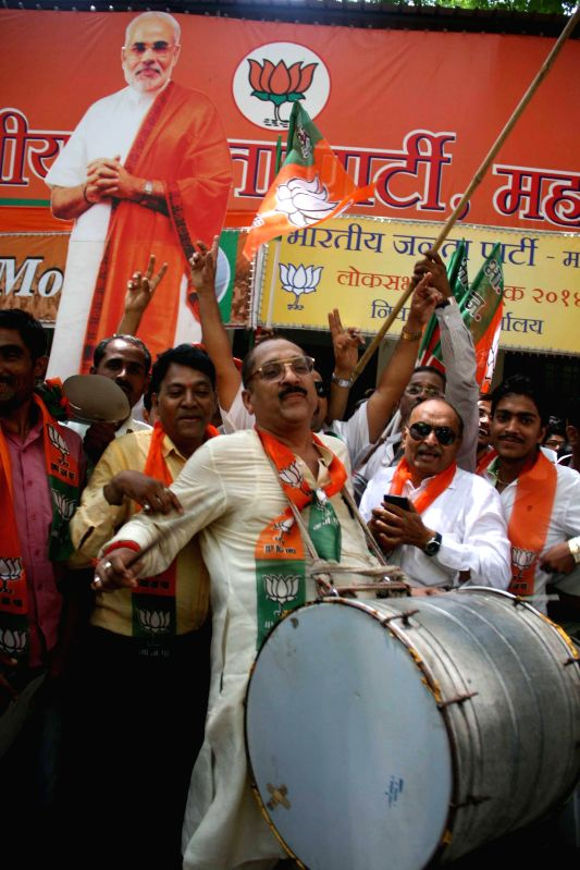 BJP workers celebrate as counting for 2014 Lok Sabha Election is underway and the party is leading nationally, in Mumbai on May 16, 2014.