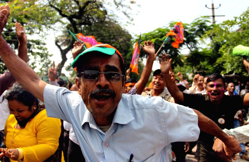 BJP workers celebrate party's candidate from Dibrugarh Parliamentary constituency Rameshwar Teli's victory in Dibrugarh on May 16, 2014.