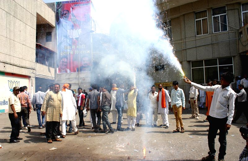 BJP workers celebrate party's performance in 2014 Lok Sabha Elections in Bhopal on May 16, 2014.
