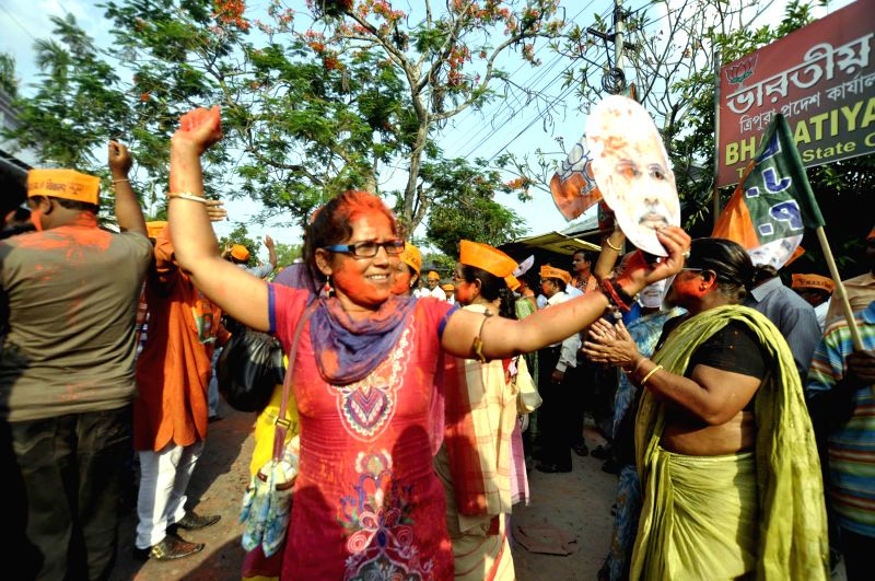 BJP workers celebrate party's performance in 2014 Lok Sabha Elections in Agartala on May 16, 2014.