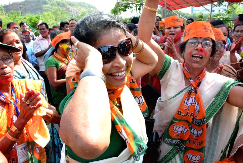 BJP workers celebrate party's performance in 2014 Lok Sabha Elections in Guwahati on May 16, 2014.