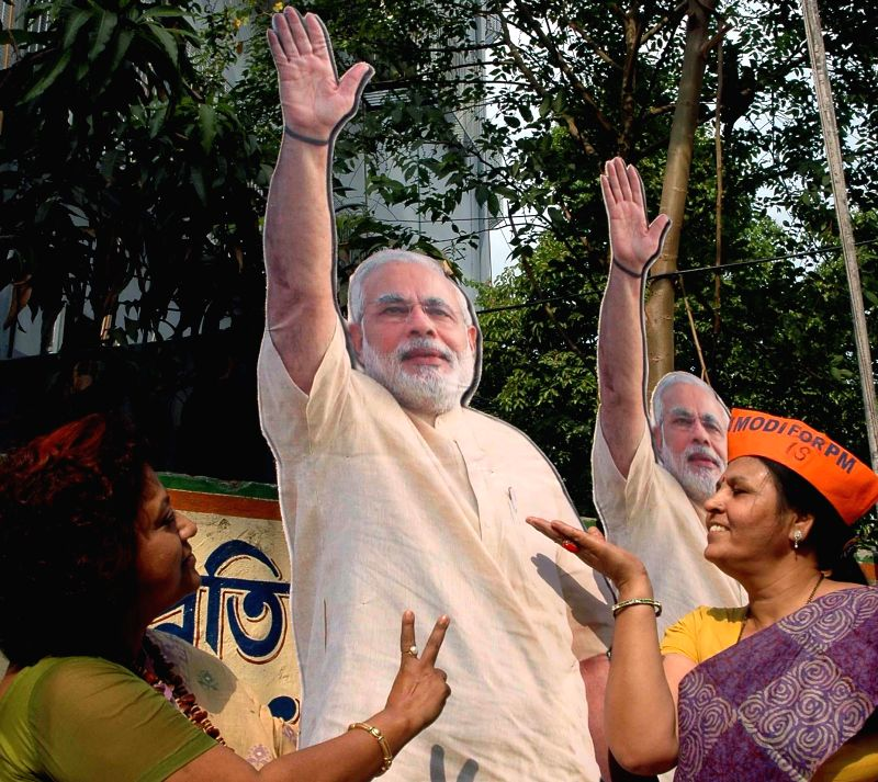 BJP workers celebrate party's performance in 2014 Lok Sabha Elections in Kolkata on May 16, 2014.