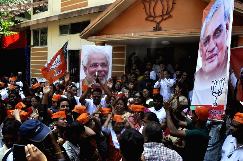 BJP workers celebrate party's performance in 2014 Lok Sabha Elections at BJP office in Guwahati on May 16, 2014.