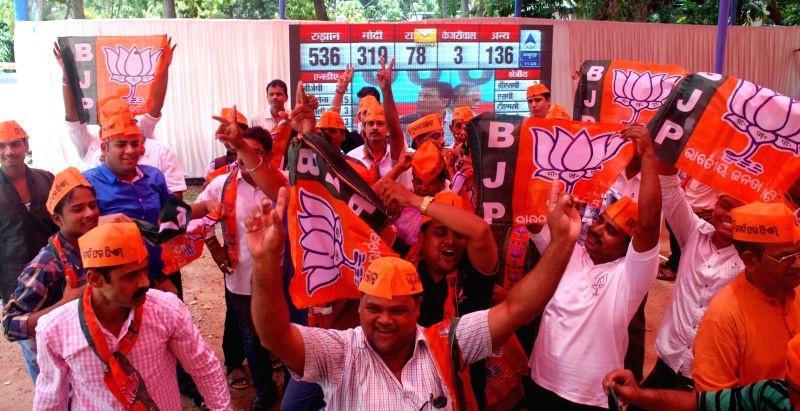 BJP workers celebrate party's performance in 2014 Lok Sabha Elections in Bhubaneswar on May 16, 2014.