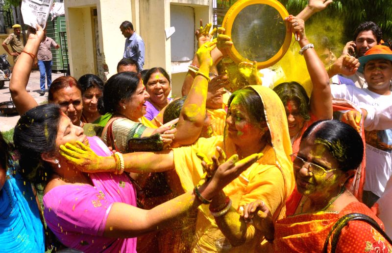 BJP workers celebrate party's performance in 2014 Lok Sabha Elections in Jaipur on May 16, 2014.