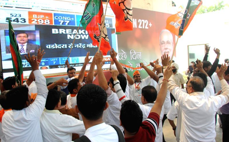 BJP workers celebrate party's performance in 2014 Lok Sabha Elections in New Delhi on May 16, 2014.