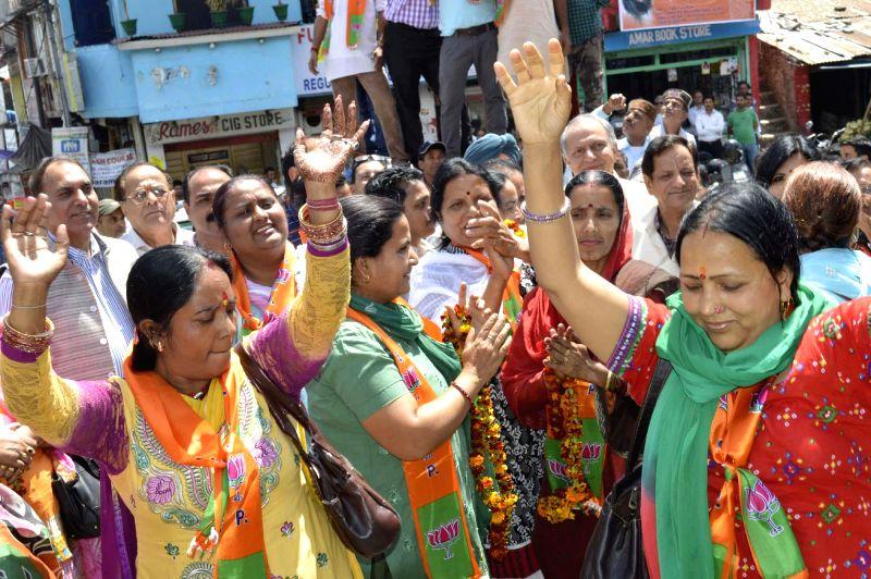 BJP workers celebrate party's performance in 2014 Lok Sabha Elections in Kangra of Himachal Pradesh on May 16, 2014.