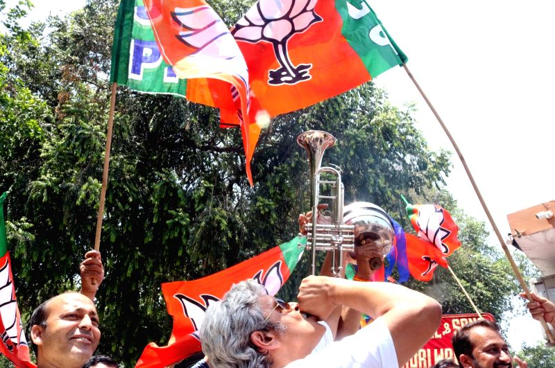 BJP workers celebrate party's performance in the recently concluded 2016 Assam assembly polls; in New Delhi, on May 19, 2016.