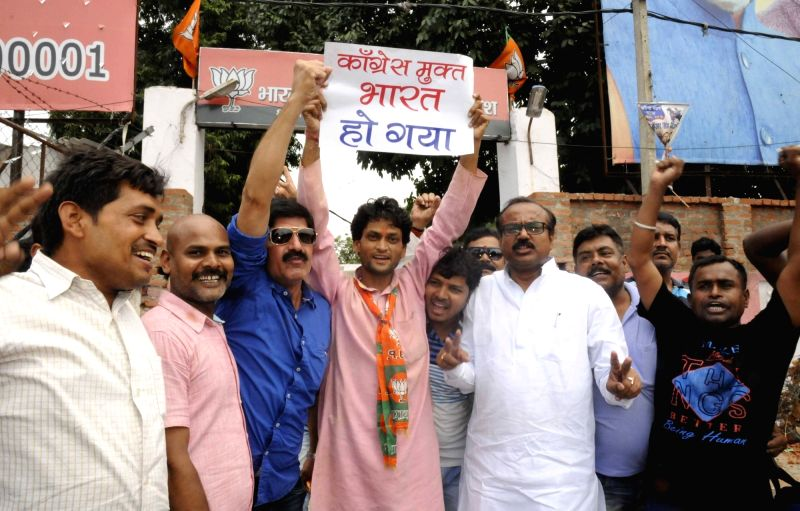 BJP workers celebrate party's performance in the recently concluded 2016 Assam assembly polls; in Patna, on May 19, 2016.