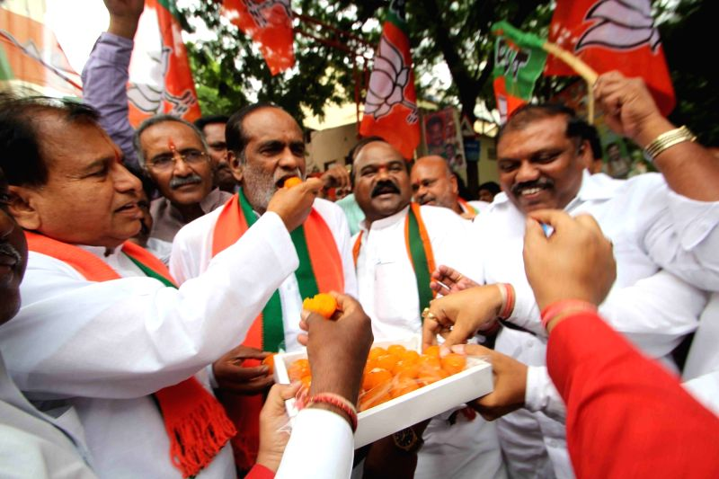 BJP workers celebrate party's performance in the recently concluded 2016 Assam assembly polls; in Hyderabad, on May 19, 2016.