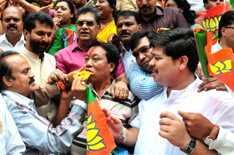 BJP workers celebrate party's performance in the recently concluded 2016 Assam assembly polls; in Bengaluru, on May 19, 2016.