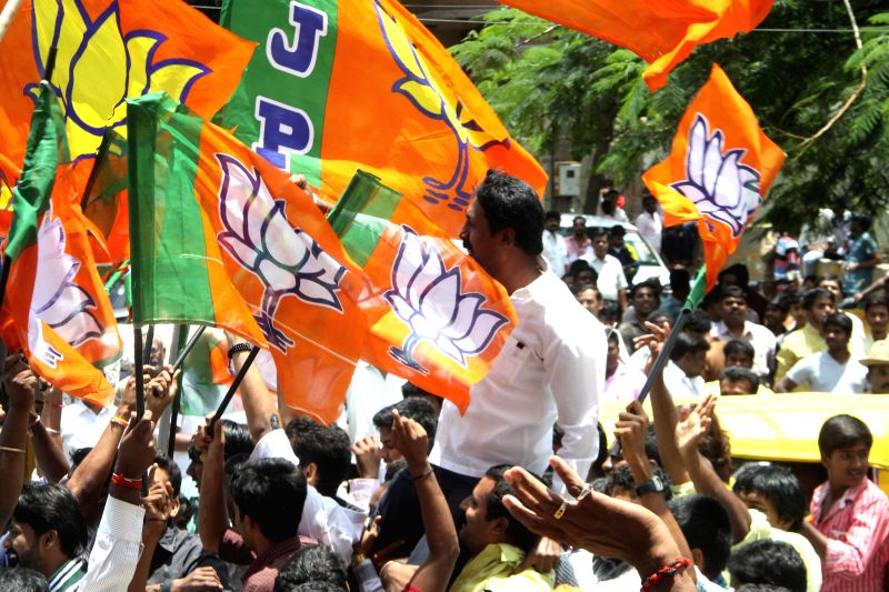 Bengaluru: BJP workers celebrate their victory in BBMP elections in Bengaluru, on Aug 25, 2015.