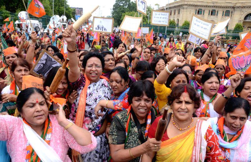BJP workers demonstrate against Akhilesh Yadav-led Uttar Pradesh government in Lucknow on July 7, 2014. - Akhilesh Yadav