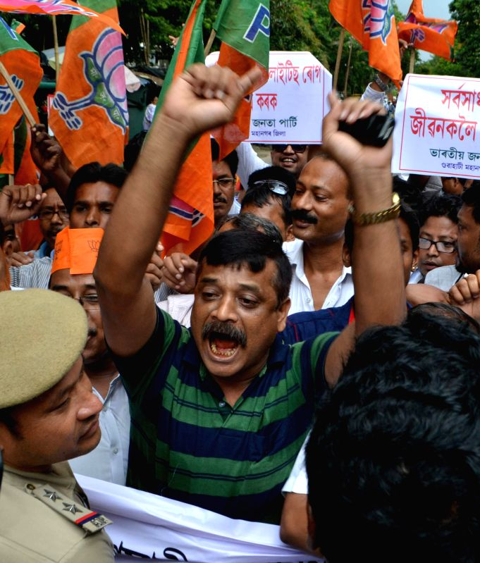 BJP workers demonstrate against failure of the state government to curb encephalitis in Guwahati on Aug 5, 2014.