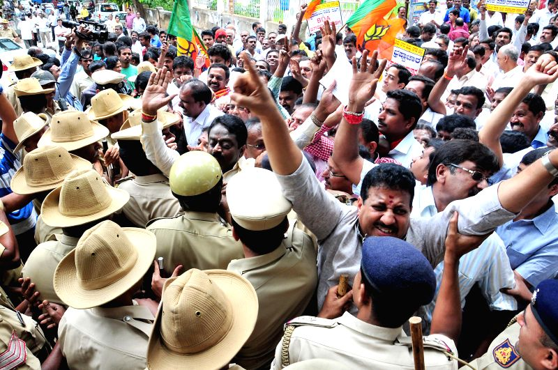 BJP workers demonstrate against Siddaramaiah led Karnataka Government in Bangalore on July 28, 2014.