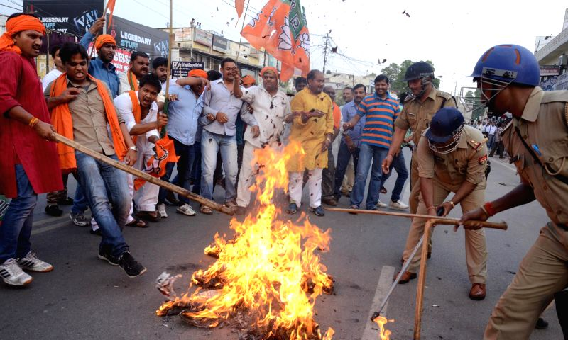 BJP workers demonstrate against Uttar Pradesh Government in Lucknow on June 22, 2014.