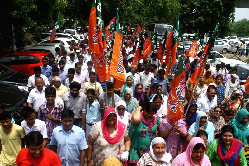 BJP workers demonstrate near BSES office in Nehru Place of New Delhi against prevailing power crisis in the national capital on July 15, 2014.
