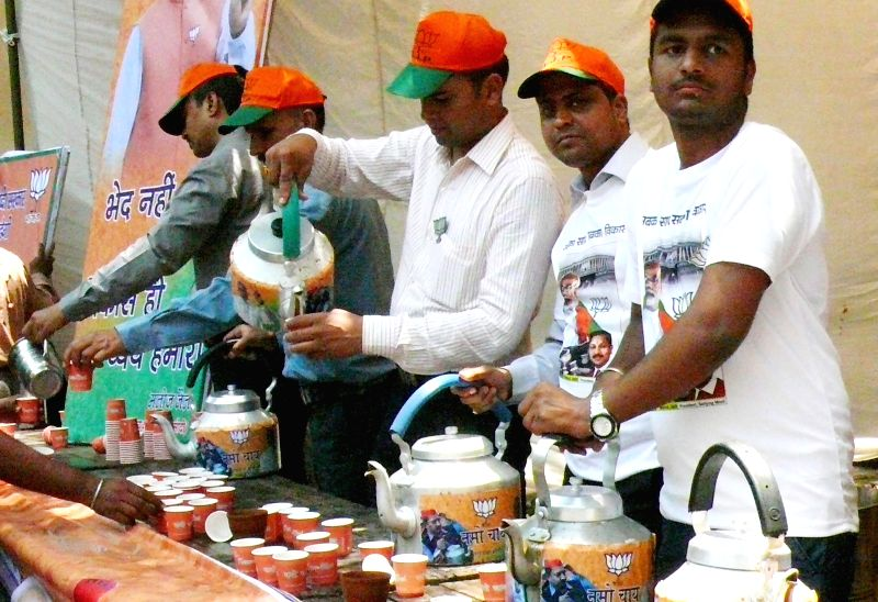 BJP workers distribute tea at BJP headquarters in New Delhi on May 16, 2014.