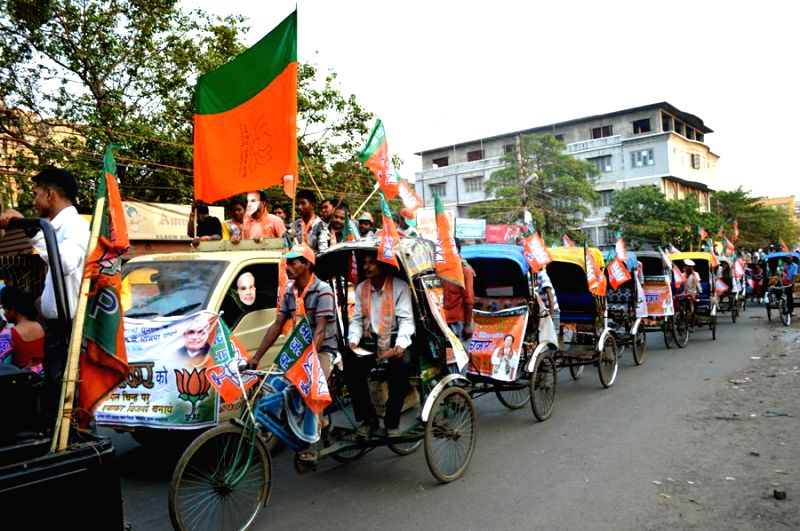 BJP workers during a rickshaw rally in Howrah of West Bengal on April 24, 2014.