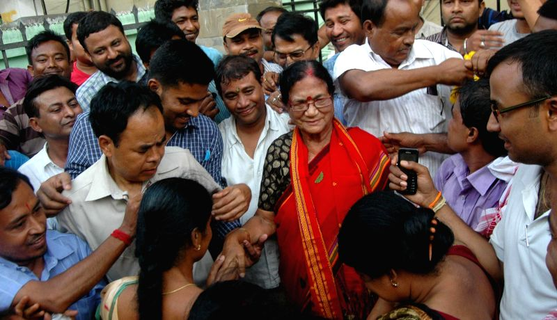 BJP workers greet party leader Bijoya Chakraborty after winning Guwahati Lok Sabha seat in Guwahati on May 17, 2014.