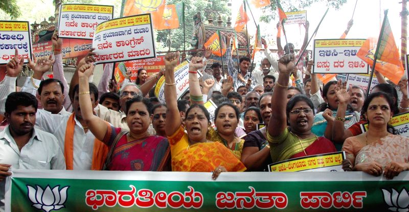 BJP workers of Bangalore City Unit demonstrate against hike in fares of KSRTC buses in Bangalore on May 5, 2014.