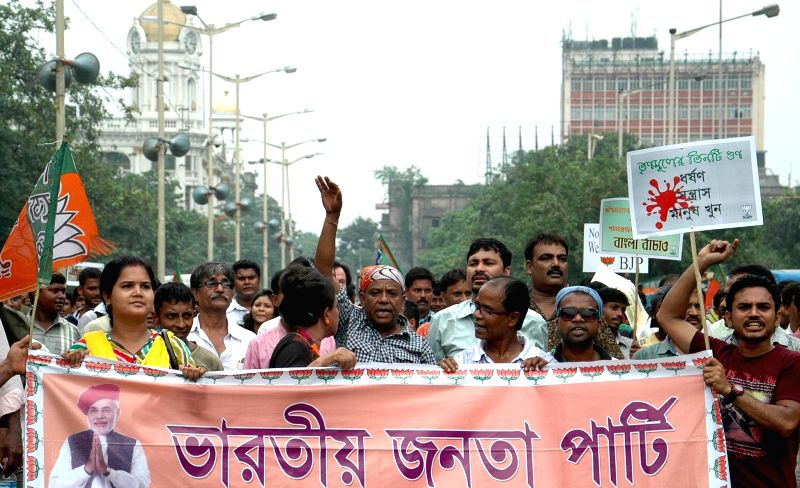 BJP workers participate in a protest rally against West Bengal Government in Kolkata on June 23, 2014.