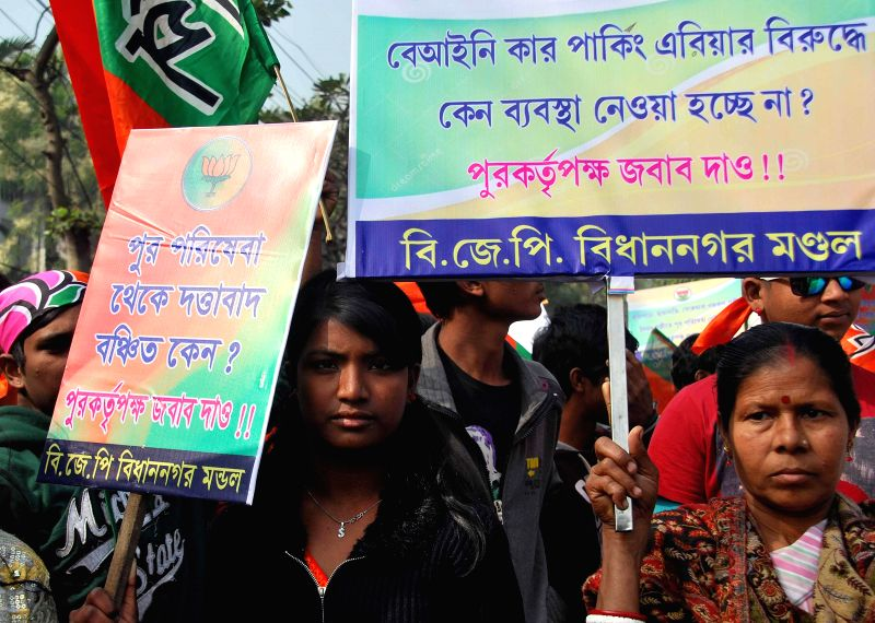 BJP workers participate in a protest rally against Salt Lake municipality in Kolkata on Jan 19, 2015.